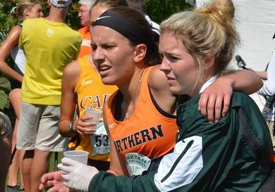 A Northern Ohio runner is helped by an MSU staffer.