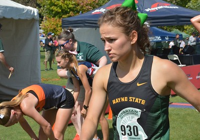 Wayne State's Jackie Feist searches for relief after the finish.