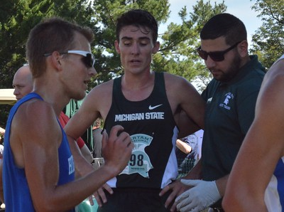Nate Burnand of Michigan State gets assistance at the finish line.