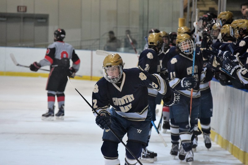 Timothy Stebbins' (12, front) first-period goal proved to be all the scoring Country Day needing in their win over the Falcons. (MIPrepZone Photo Gallery by Alex Muller)