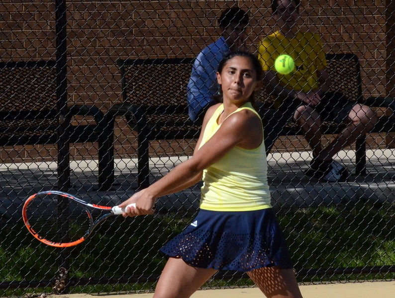 Detroit Country Day's Nina Khaghany loads up for a backhand during her win at No. 4 singles Monday afternoon. Her Yellowjackets defeated Bloomfield Hills, 5-3, in a matchup of Oakland County's two best teams. (MIPrepZone photo by Jason Schmitt)