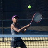 Bloomfield Hills' Alandria Bellamy readies herself to hit a volley during her team's match against Detroit Country Day. He and partner Lauren Walkon won their second doubles match in three tight sets. (MIPrepZone photo by Jason Schmitt)
