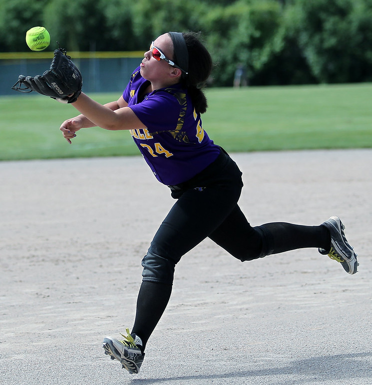 . Alexis Christoff, Auburn Hills Avondale, makes a play makes a play in the infield during district final softball action against Birmingham Seaholm at Birmingham Groves High School Saturday, June 2, 2018. Avondale fell to the Maples 10-2. (For The Oakland Press / LARRY McKEE)