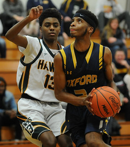 Oxford's Dujoun Williams (2) keeps his eyes on the basket as Farmington Hills Harrison's Marcio Dell defends during the OAA Blue match up played on Friday January 4, 2019 at Harrison HS.  The Wildcats won the game 79-48.  (Digital First Media photo by KEN SWART)