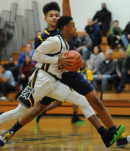 Farmington Hills Harrison's London Young (24) drives around Zachary Townsend of Oxford for two of his game high 24 points during the OAA Blue match up played on Friday January 4, 2019 at Harrison HS.  The Hawks lost to the Wildcats 79-48.  (Digital First Media photo by KEN SWART)