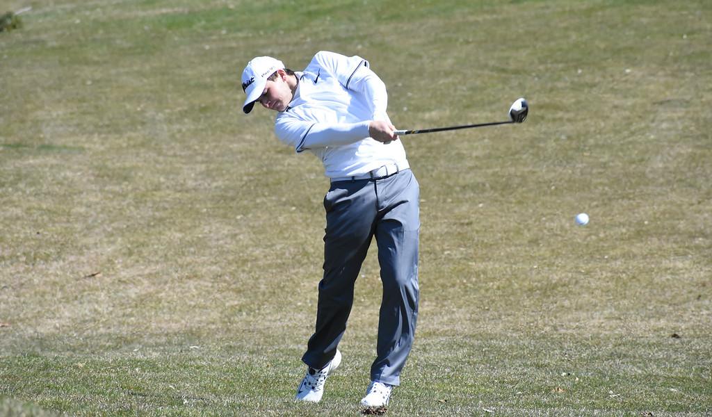. Berkley\'s Jake Radom hits his approach shot on the 16th hole Friday at the Farmington Invitational at Farmington Hills Golf Club. (The Oakland Press photo gallery by Jason Schmitt)
