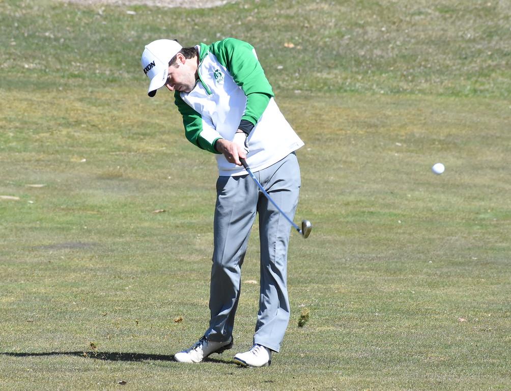 . Birmingham Groves senior Nathan Brink hits an iron shot on the 14th hole Friday at the 32nd Annual Farmington Invitational at Farmington Hills Golf Club. (The Oakland Press photo gallery by Jason Schmitt)