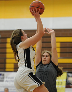 Kelsey Newton of North Farmington drives the lane and shoots over Farmington's Cecilia Norris during the OAA cross over game played on Wednesday January 9, 2019 at North Farmington HS.  The Raiders won the game 33-29. (Digital First Media photo by Ken Swart)