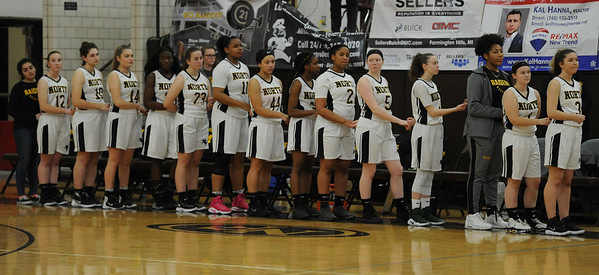 The North Farmington Raiders outscored the Farmington Falcons 18-7 in the fourth quarter to earn a 33-29 win the the OAA cross over game played on Wednesday January 9, 2019 at North Farmington HS.  (Digital First Media photo by Ken Swart)