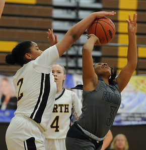 North Farmington's Maya Kelly (2) blocks the shot attempt of Farmington's Iasia Rimson during the OAA cross over game played on Wednesday January 9, 2019 at North Farmington HS.  The Raiders earned a 33-29 win over the Falcons. (Digital First Media photo by Ken Swart)