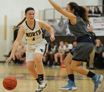 Molly Simpson (1) of North Farmington looks to move around Farmington's Kayla Ghafari during the OAA cross over game played on Wednesday January 9, 2019 at North Farmington HS.  Simpson had a team high 12 points to help lead the Raiders to a 33-29 win. (Digital First Media photo by Ken Swart)