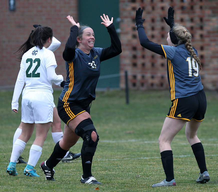 . Laurel Krause (21), Madison Heights Bishop Foley, celebrates after scoring a goal with teammate Mackenzie Kopf (19), during varsity soccer action at Cranbrook-Kingswood Saturday, April 14, 2018. Foley downed the Cranes 2-0. (For The Oakland Press / LARRY McKEE)