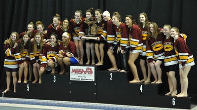 The Farmington Hills Mercy Marlins show off the MHSAA D1 state title that they won during the meet held on Saturday Nov. 18, 2017 at Oakland University.  (Oakland Press photo by Ken Swart)