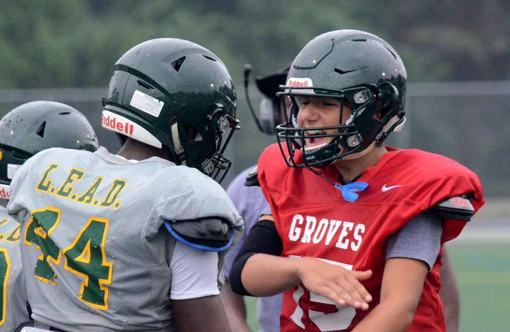 . Birmingham Groves and Bloomfield Hills met in a football scrimmage on Thursday, a week before the start of the regular season. The scrimmage was held at Groves High School. (Oakland Press photo by Drew Ellis)