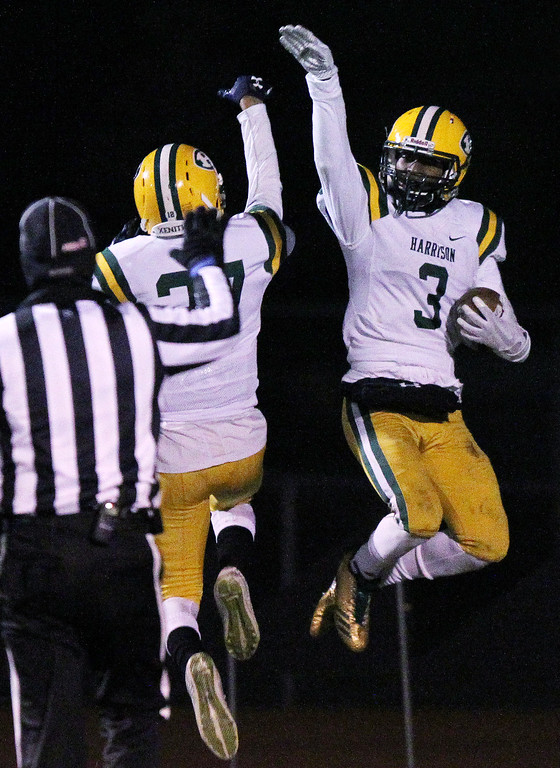 . Roderick Heard (3), Farmington Hills Harrison, celebrates after scoring a touchdown during regional final football action against Linden Friday, Nov. 10, 2017. Visiting Harrison went on to defeat Linden 34-21. (For The Oakland Press / LARRY McKEE)