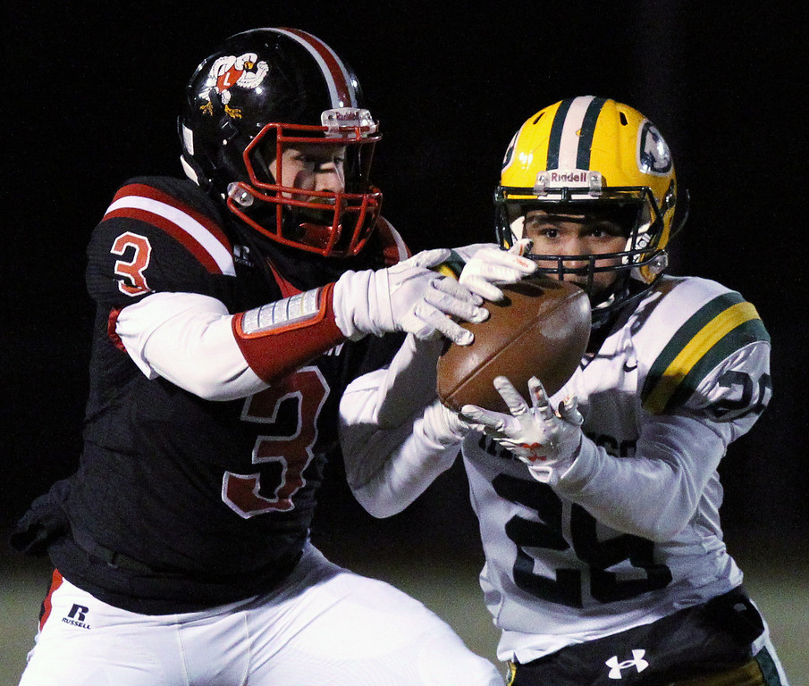 . Moet Andrews (26), Farmington Hills Harrison, attempts to make an interception as Hunter Babcock (3), Linden, attempts to make a reception during regional final football action at Linden High School Friday, Nov. 10, 2017. Harrison went on to defeat Linden 34-21. (For The Oakland Press / LARRY McKEE)
