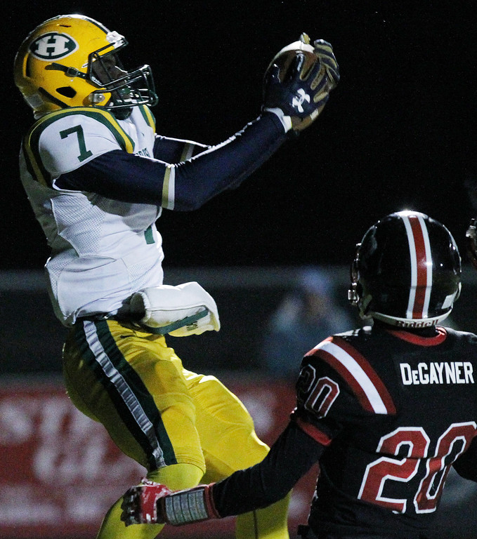. Ovie Ohhoufo (7), Farmington Hills Harrison, goes up for a touchdown reception during regional final football action against Linden Friday, Nov. 10, 2017. Visiting Harrison went on to defeat Linden 34-21. (For The Oakland Press / LARRY McKEE)