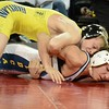 Hartland's Kyle Cantola is in control of Oxford's Daltan Myers. Defending Division 1 state champion Hartland ousted Oxford in the quarterfinals of the Division 1 team state wrestling championships Friday at McGuirk Arena on the Central Michigan University campus. (MIPrepZone photo gallery by MARVIN GOODWIN).