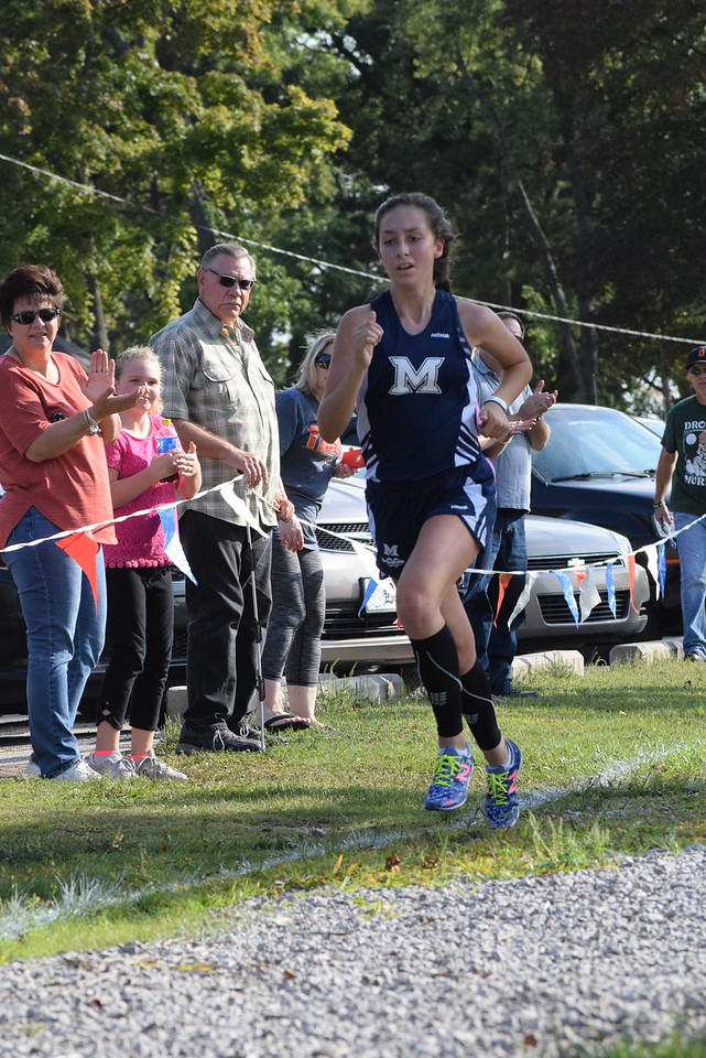 Megan McCulloch of Marysville wins the girls race. MAC Blue Division cross country teams ran their first jamboree of the season at Marysville Park on Sept. 12, 2017. THE MACOMB DAILY PHOTO GALLERY BY GEORGE POHLY