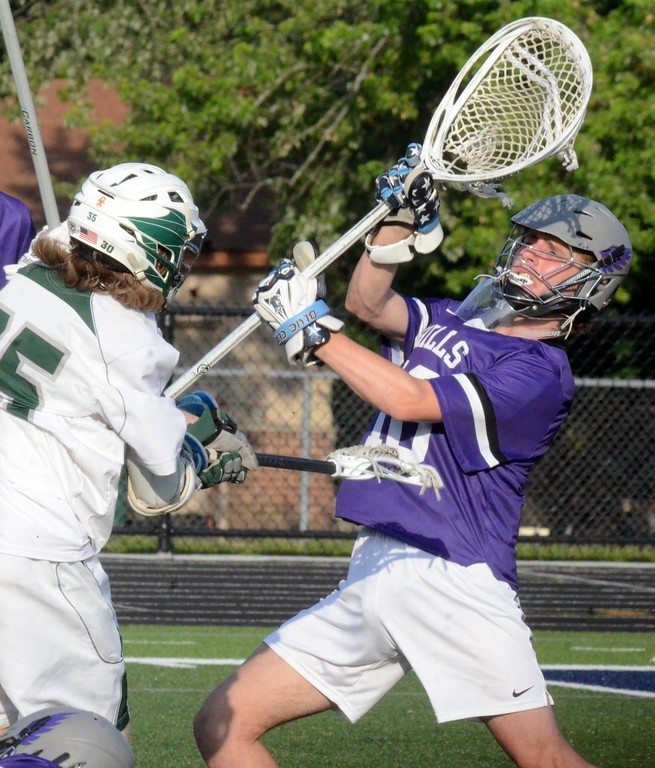 . The Bloomfield Hills boys lacrosse team won its first regional championship on Tuesday thanks to an 8-7 win over Lake Orion at Clarkston High School. (Oakland Press photo gallery by Drew Ellis)