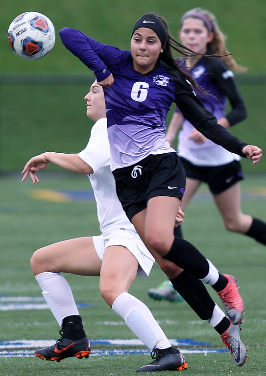 . Anastasia Curti (6), Bloomfield Hills, attempts to get in front of a goal kick in front of Amelia Kuntzman, Rochester Hills Stone Creek, during varsity soccer action at Stoney Creek High School Thursday, May 3, 2018. The visiting Blackhawks defeated the Cougars 2-1. (For The Oakland Press / LARRY McKEE)
