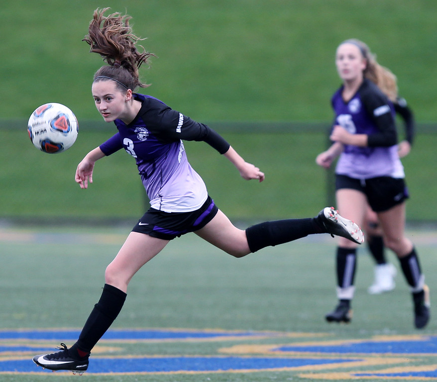 . Isabelle Harber (3), Bloomfield Hills, makes a header pass during varsity soccer action at Rochester Hills Stoney Creek High School Thursday, May 3, 2018. The visiting Blackhawks ran past Stoney Creek for a 2-1 victory. (For The Oakland Press / LARRY McKEE)