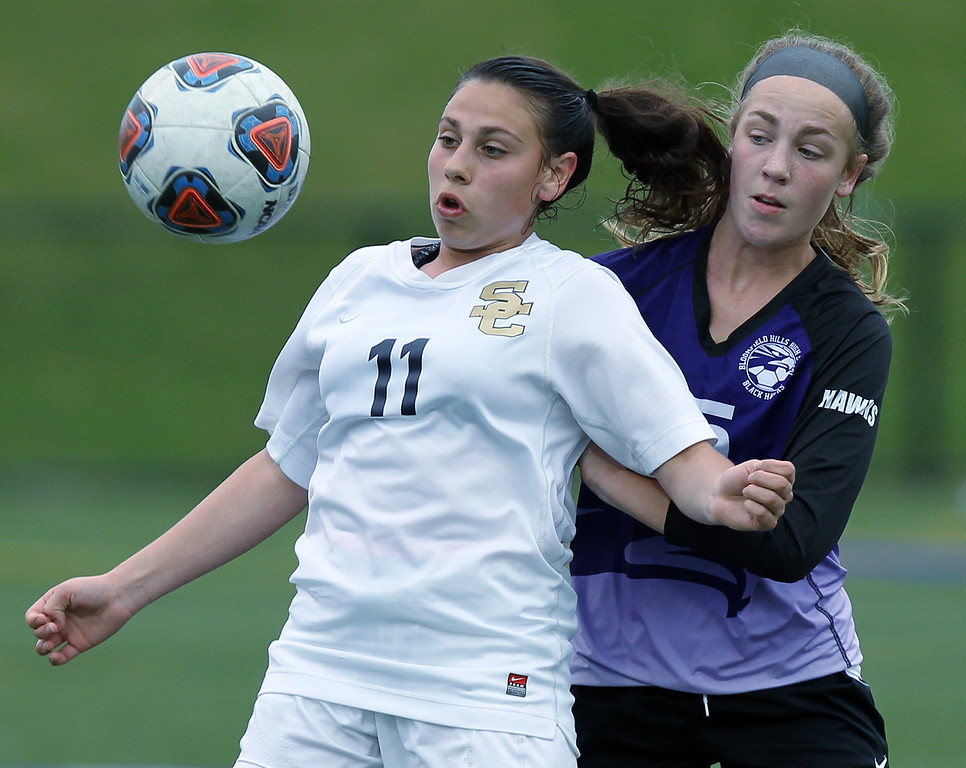 . Christina Buca (11), Rochester Hills Stoney Creek, steps in front of midfielder Molly Paulon, Bloomfield Hills, during varsity soccer action at Stoney Creek High School Thursday, May 3, 2018. The visiting downed the Cougars 2-1. (For The Oakland Press / LARRY McKEE)