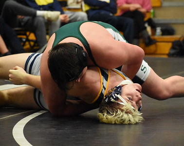 Waterford Kettering's Jesse Pieper (top) pinned Clarkston's Drew Stark with just 15 seconds left in their 285-pound match Wednesday night at Troy High School. (Digital First Media photo by Jason Schmitt)