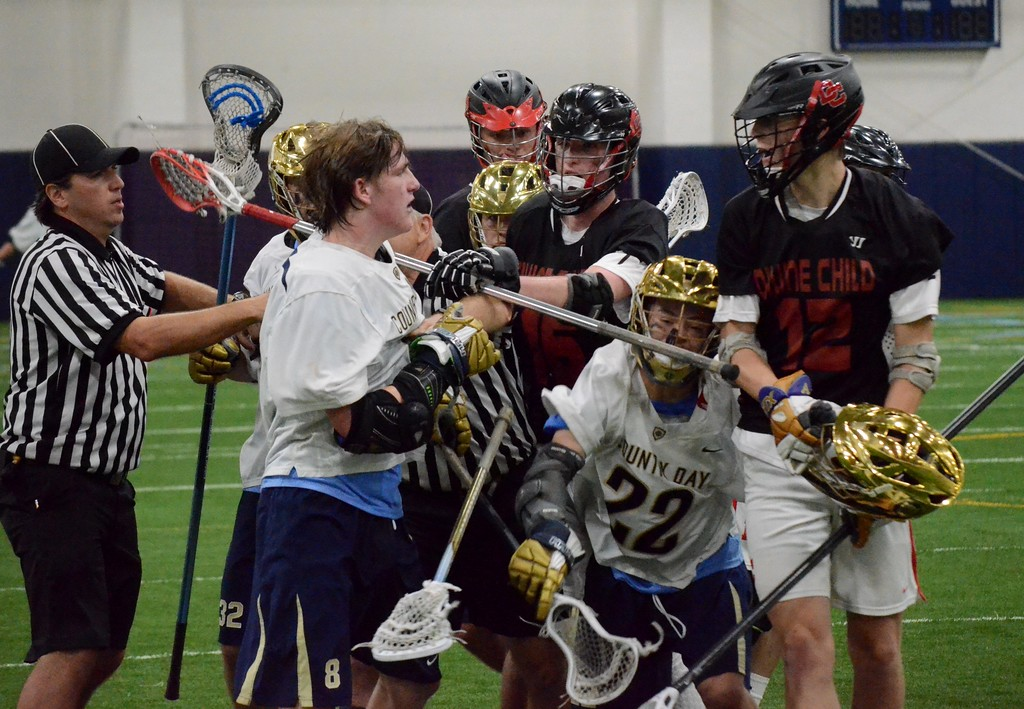 . Birmingham Detroit Country Day defeated Dearborn Divine Child on Wednesday, 10-7, in a Division 2 regional boys lacrosse championship game. (Oakland Press photo gallery by Drew Ellis)