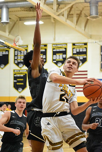 Bloomfield Hills Cranbrook-Kingswood traveled to Madison Heights Friday night to take on host Bishop Foley, and the Cranes picked up a 67-57 road victory. (Digital First Media photo by Jason Schmitt)