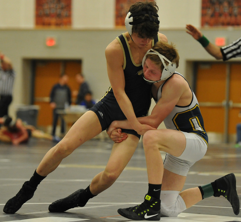 . Oxford\'s Ashton Anderson (R) battles with Andy Hampton of Stoney Creek in the 112 pound weight class during the D1 individual district held on Saturday Feb. 18, 2018 at Troy HS.  Anderson won the 112# flight with Hampton finishing in 3rd.  (Oakland Press photo by ken Swart)