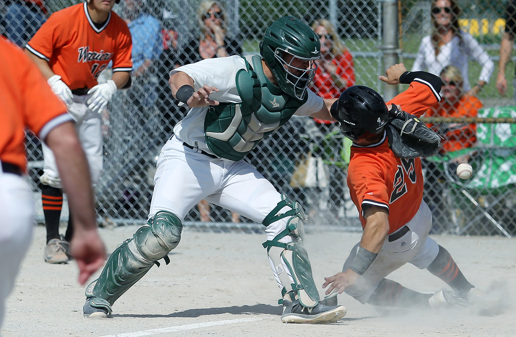 . Jack Orlowski (25), Birmingham Brother Rice, jars the ball loose from catcher George Cutler, Birmingham Groves, in what turned out to be the winning run in the Warriors 7-3 win over Groves in district final baseball action at Groves High School Saturday, June 2, 2018. (For The Oakland Press / LARRY McKEE)