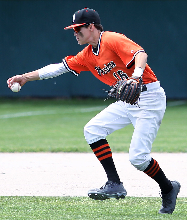 . Josh Anschuetz, Birmingham Brother Rice, attempts to barehand an infield grounder during district final baseball action against Birmingham Groves Saturday, June 2, 2018. Rice defeated Groves 7-3. (For The Oakland Press / LARRY McKEE)