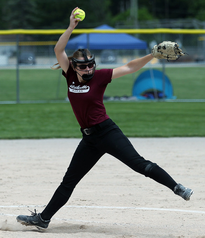 . Erika MacArthur, Birmingham Seaholm, delivers a pitch during district final softball action against Auburn Hills Avondale at Birmingham Groves High School Saturday, June 2, 2018. MacArthur helped her team win the district championship by tossing a complete game in a 10-2 victory over Avondale. (For The Oakland Press / LARRY McKEE)