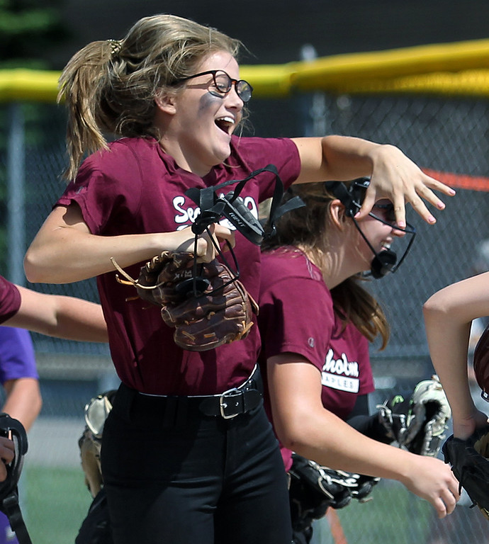 . Kate Bridges, Birmingham Seaholm, celebrates with teammate Erika MacArthur, after defeating Auburn Hills Avondale 10-2 in district final softball action at Birmingham Groves High School Saturday, June 2, 2018. (For The Oakland Press / LARRY McKEE)
