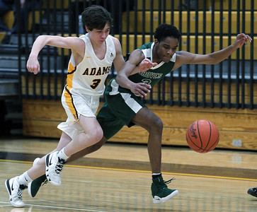 Gunner Walters (3), Rochester Adams, attempts to steal the ball away from Eyan Bell, Birmingham Groves, during varsity basketball action at Adams High School Friday, Feb. 8, 2019. The game was tight throughout, but it was the Highlanders who pulled it out in the end defeating Groves 47-38. (For The Oakland Press / LARRY McKEE)