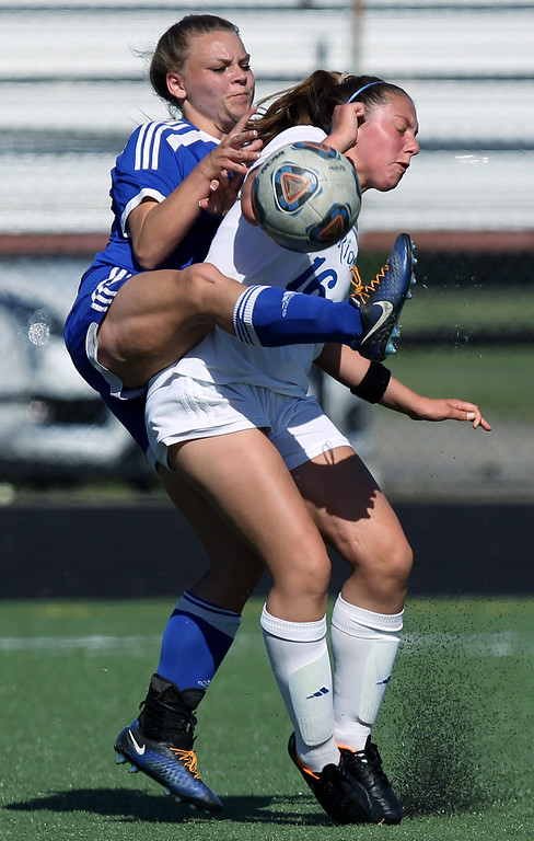 . Chloe Abelarde (16), Birmingham Marian, collides with Olivia Avery, Madison Heights Lamphere, during regional semifinal soccer action at Hurley Field in Berkley Wednesday, June 6, 2018. The Mustangs dominated throughout downing Lamphere 9-1. (For The Oakland Press / LARRY McKEE)