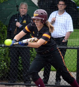 The Regina softball team edged Farmington Hills Mercy on Monday in the CHSL A/B championship at U-D Mercy, 5-4. (Digital First Media photo gallery by Drew Ellis)