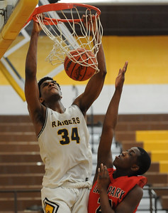 North Farmington's Yusuf Jihad (34) slams home two of his game high 25 points over Oak Park's Michael Lewis during the OAA Red match up played on Thursday February 7, 2019 at N. Farmington HS. The Raiders lost to the Knights 56-55. (Digital First Media photo by Ken Swart)