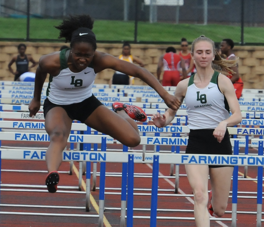 . Madison Eaton (L) of Lake Orion clears the last hurdle on her way to winning the women\'s 100M hurdle race in 14.68 seconds during the 2nd annual New Balance Invitational track meet held on Saturday May 5, 2018 at Farmington High School.  (Oakland Press photo by Ken Swart)