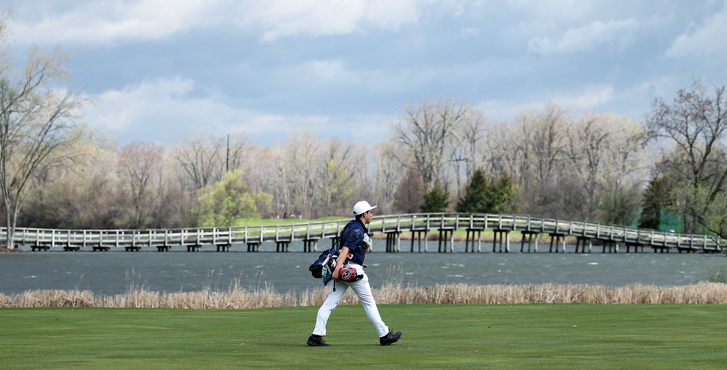 . Joey Gordon, Frankel Jewish Academy, walks up the fairway toward his ball during Oakland County Championship golf action at The Links of Crystal Lake Friday, May 4, 2018. (For The Oakland Press / LARRY McKEE)