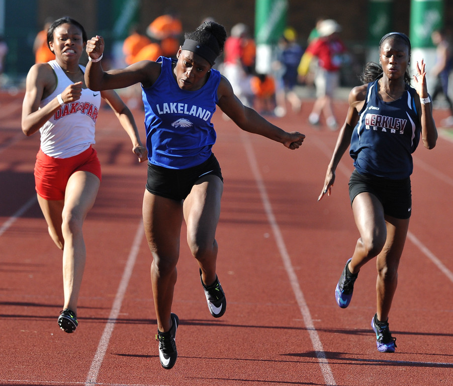 . Grace Stark of Lakeland wins the 100M dash in front of Oak Park\'s Miyah Brooks and Berkley\'s Taylor Rucker during the 59th annual Oakland Country Track meet held on Friday May 25, 2018 at Novi High School.  Stark also won the 100M hurdle event.  (Oakland Press photo by Ken Swart