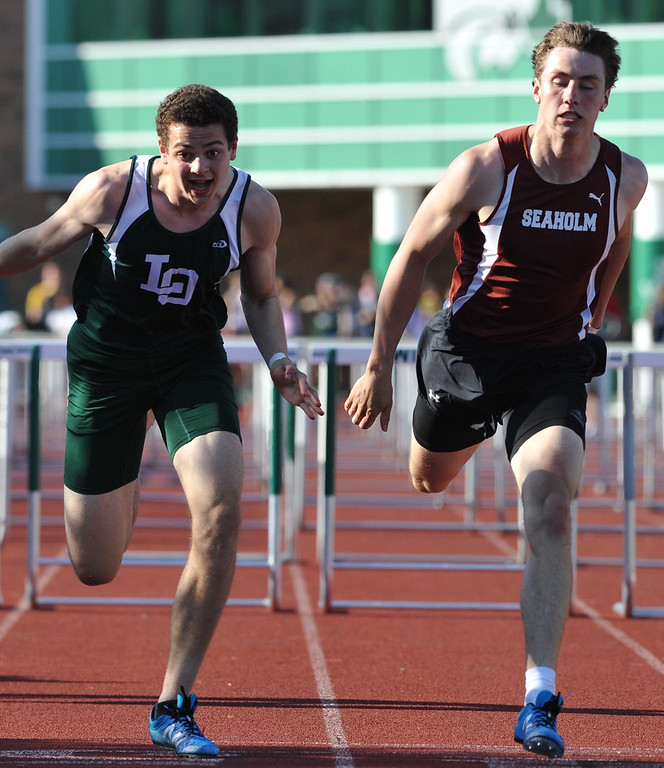 . Lake Orion\'s Thomas Moreman (L) edges out Birmingham Seaholm\'s Ben Barton by 0.04 to win the 110M hurdle event during the 59th annual Oakland Country Track meet held on Friday May 25, 2018 at Novi High School.  Oak Park won both the girls and boys titles. (Oakland Press photo by Ken Swart