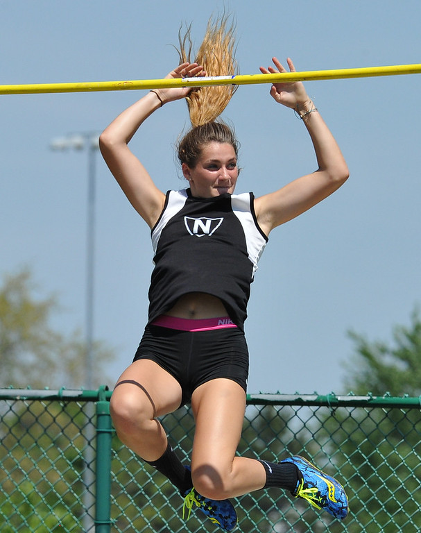 """. Tracy Lauren of Walled Lake Northern clears 10\'3\"""" for a personal record during the 59th annual Oakland Country Track meet held on Friday May 25, 2018 at Novi High School.  Oak Park won both the girls and boys titles. (Oakland Press photo by Ken Swart"""