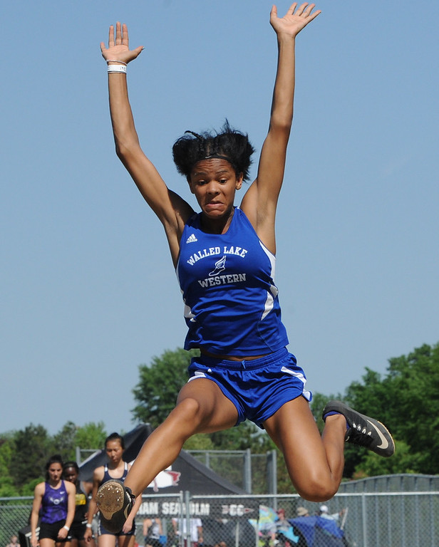 """. Walled Lake Western\'s Jackson Kennedy won the long jump with a jump of 18\' 1.5\""""  during the 59th annual Oakland Country Track meet held on Friday May 25, 2018 at Novi High School.  Oak Park won both the girls and boys titles. (Oakland Press photo by Ken Swart"""