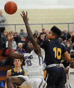 Pontiac's Terah Hazard (33) battles for the ball with Oxford's Zachary Townsend (10) during the game played on Tuesday February 19, 2019 at Pontiac HS. The Wildcats defeated the Phoenix 76-39 to take over sole possession of first place in the OAA Blue Division.  (KEN SWART for Media News Group)