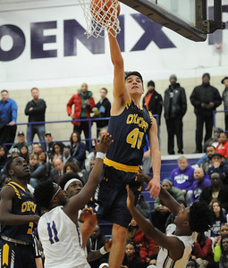 Michael Raisch (40) of Oxford puts in two of his game high 21 points between Pontiac's Keyshaun Shelmonson-Bey (11) and Ernesto Simpson Jr. during the game played on Tuesday February 19, 2019 at Pontiac HS. The Wildcats defeated the Phoenix 76-39 to take over sole possession of first place in the OAA Blue Division.  (KEN SWART for Media News Group)
