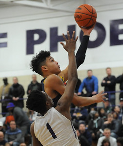 Trey Townsend of Oxford lays up a shot over Da'Veaun Cole (1) of Pontiac during the game played on Tuesday February 19, 2019 at Pontiac HS. The Wildcats defeated the Phoenix 76-39 to take over sole possession of first place in the OAA Blue Division.  (KEN SWART for Media News Group)