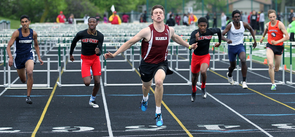 . Ben Barton, Birmingham Seaholm, crosses the finish line ahead of the competition and took first place honors in the 110-yard hurdles with a time of 15:06 during regional final track action at West Bloomfield Saturday, May 19, 2018. (For The Oakland Press / LARRY McKEE)