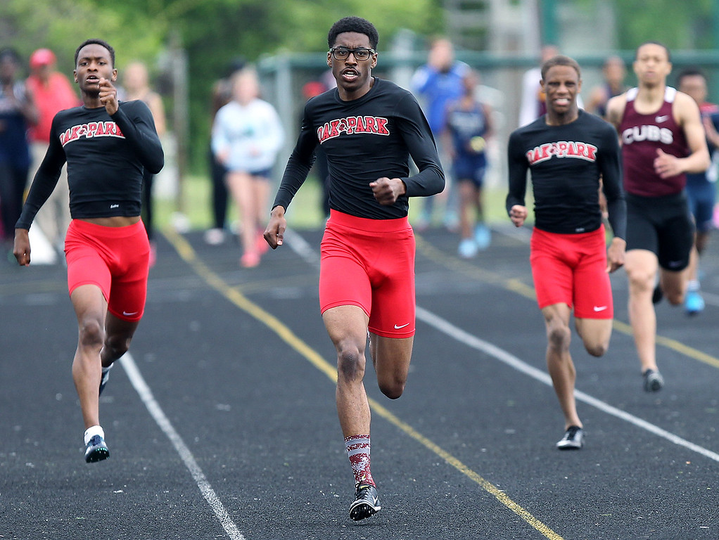 . Donnie James (center), Jacob Williams (left) and Jason Flake (right), swept the 400-yard dash during regional final track action at West Bloomfield Saturday, May 19, 2018. Oak Park captured the boys team championship with 134 points. (For The Oakland Press / LARRY McKEE)